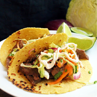 Korean Bulgogi Tacos with Kimchi Slaw and Sriracha Sour Cream.