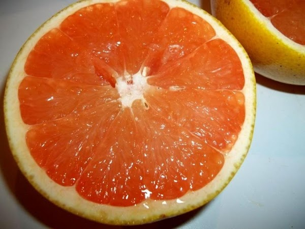 Turn on broiler.  Cut your grapefruit, evenly in half.