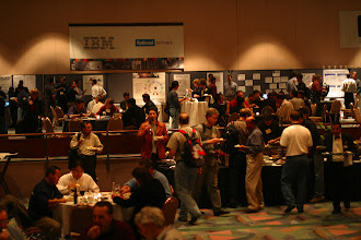 Photo: Busy post sessions at the evening reception, EclipseCon 2004