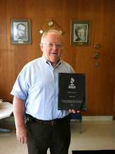 Photo: Kevin Coan, President of Coan Inc. in Natick, MA with their plaque celebrating 50 years as an Accredited Business