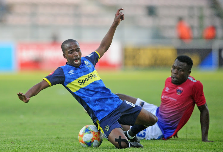 Thabo Nodada of Cape Town City is fouled by Meshack Maphangule of Chippa United during the Absa Premiership 2019/20 game between Cape Town City and Chippa United at Athlone Stadium in Cape Town on 7 December 2019.