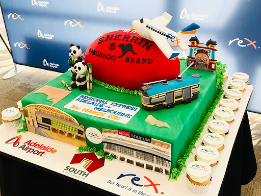 Adelaide Airport celebrates Rex launch to Melbourne with award-winning cake