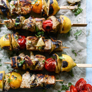 Grilled Chicken, Burst Tomato and Artichoke Skewers with Goat Cheese Dip.