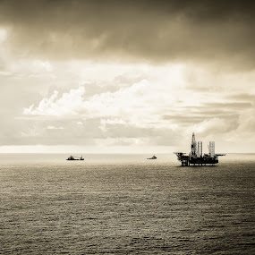 Relocation. by Michael Tan - Landscapes Waterscapes ( sigma 50mm f1.4, clouds, oil rig, sea, canon 60d, drilling rig )