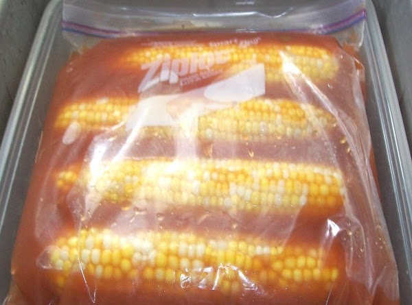 Clean the corn, and place them in a large zip lock baggie, carefully pour...
