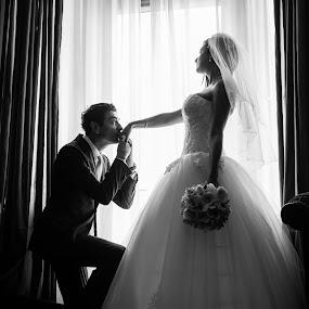 by the window by Jovan Barajevac - Wedding Bride & Groom ( srbija, novi sad, black and white, by the window, romantic, kissing hand, bride, wedding photo session, groom )