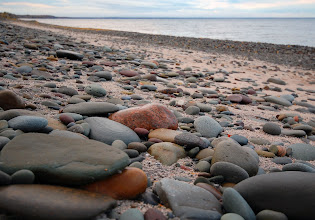 Photo: Smooth stones lie on the beach at Rainbow Shores on the eastern edge of Lake Ontario in Pulaski, NY.