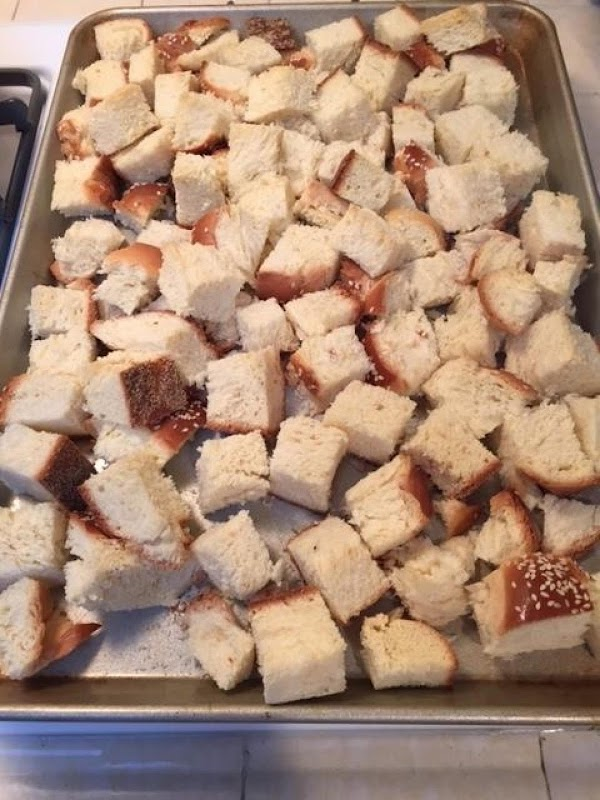 Do ahead of time: If the bread is not stale, cut into cubes, place...
