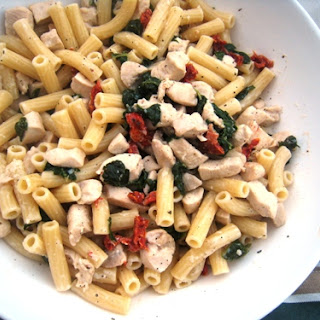 Creamy Chicken Pasta with Spinach and Tomatoes.