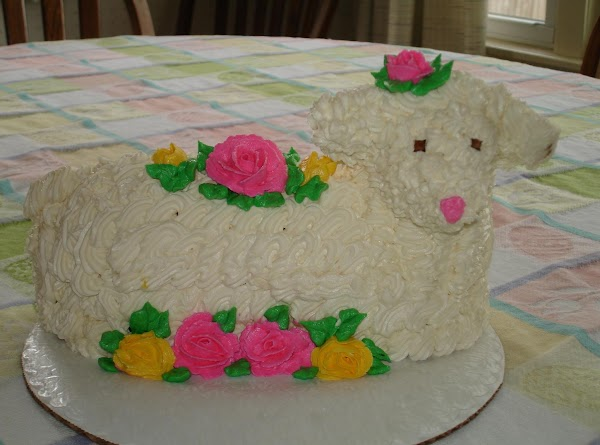 When the cake is solidly cooled, place a dollop of icing on your cake...