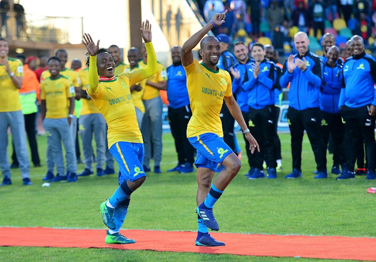 Percy Tau accompanied Tiyani Mabunda of Mamelodi Sundowns to receive his medals with dance during the Absa Premiership 2017/18 football match between Bloemfontein Celtic and Mamelodi Sundowns at Dr Petrus Molemela Stadium, Bloemfontein on 12 May 2018.