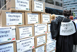 Photo: A symbolic replica of the several boxes of documents belonging to Mohammad Mahjoub and his defense that were illegally stolen by the Department of Justice.