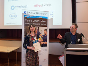 Photo: Dr Steven Petratos congratulating the winner of the Young Investigator poster competition, Dr Rebecca Segrave. http://www.med.monash.edu.au/cecs/events/2015-tr-symposium.html