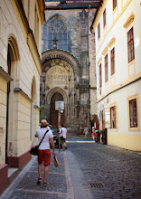 Photo: A happy tourist in Prague Old Town.