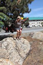 Photo: Stop 6 - Dianna Hardisty on top bedload boulder along Apple Capital Loop Trail, Wenatchee, WA