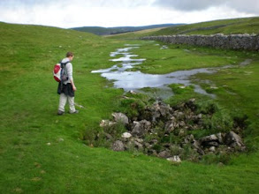Photo: PW - Thomas looking a sink hole on the way between Ing Scar and Malham Tarn