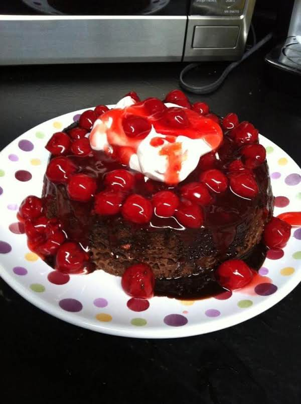 Rich Devil's Food Cake With Chocolate Lava...topped With Cherries And Whip Cream.