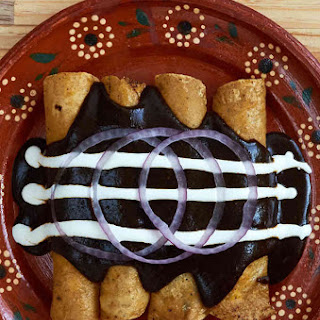 Cheese Enchiladas With Mole Sauce.