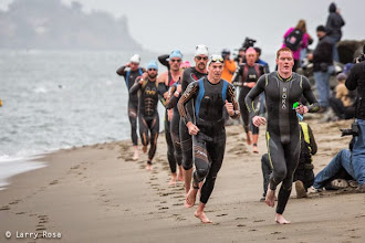 Photo: A pack of pro men exit swim and run up the beach at the 2014 Escape from Alcatraz Triathlon on June 1, 2014 in San Francisco, CA