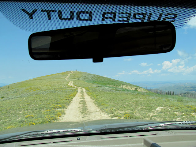 Looking out the windshield at the road up Monument Peak