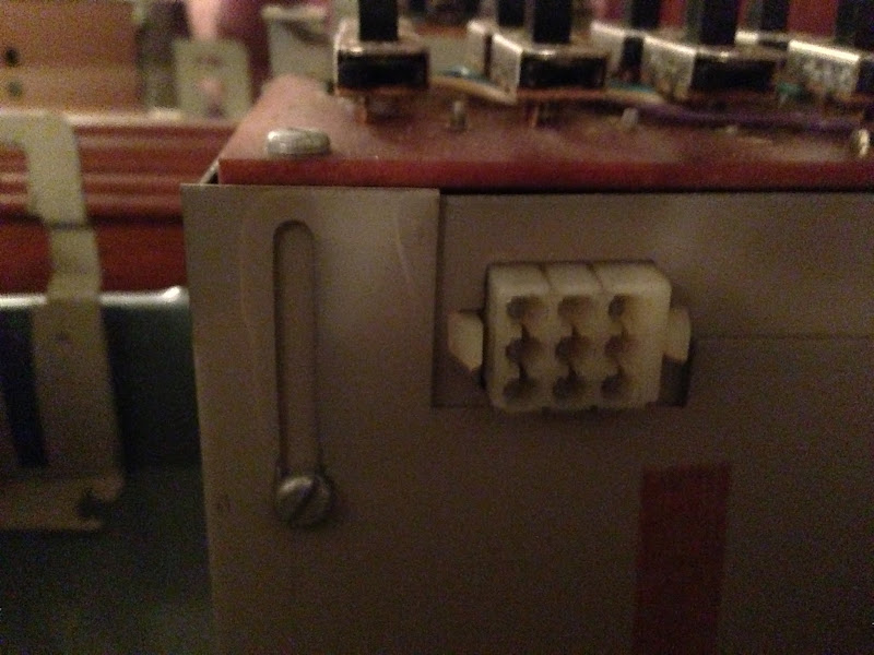 Photo: We're looking at the connector that accepts a wire from the front panel. Also notice the slot for the phillips screw. This is the only screw that must be completely removed to remove the switch unit.