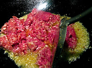 Photo: stir-frying ground pork with chopped garlic