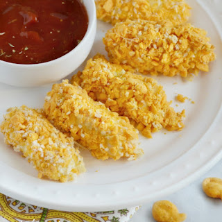 Baked Mozzarella Sticks with Goldfish Cracker Crust