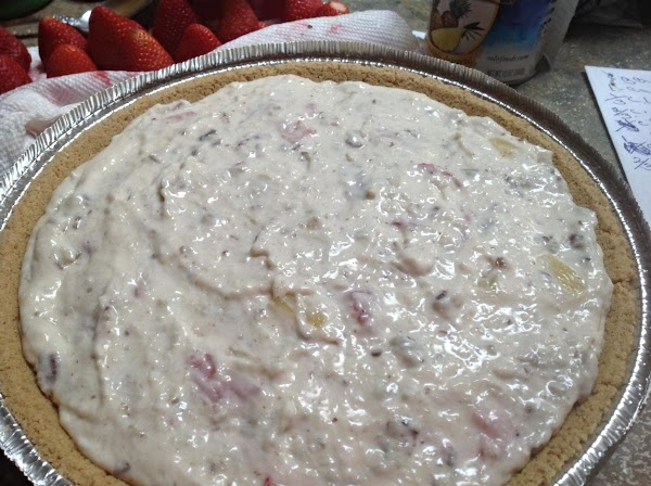 Pour mixture into Graham Cracker Crust and smooth  over the top with back...