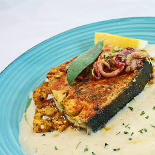 Pan Seared Halibut Steaks with Creamy Lemon Dill White Sauce.