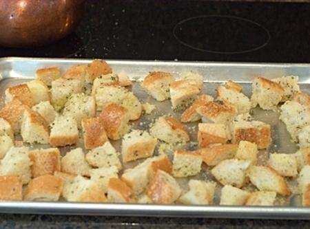 Cube bread. put on bakeing sheet drizzle with olive oil s&p and garlic powder...