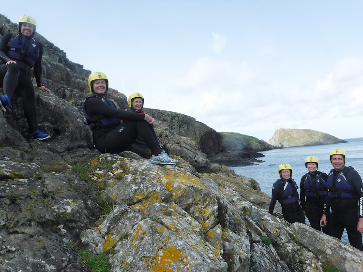 Here's our merry band of coasteering adventurers — that's me at the upper left. (Click to enlarge.)