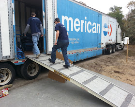 Photo: December 13, 2012 We're feeling a little better with some sleep not taken on the road. The movers arrive with our load, right on time.
