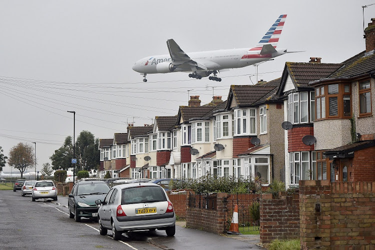 An aircraft approaches landing over houses close to Heathrow airport in London. Picture: EPA/HANNAH MCKAY