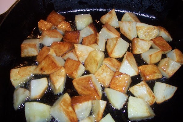 Once potatoes are brown,  add your onions and peppers. let them simmer for awhile...