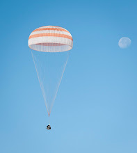 Photo: The Soyuz TMA-21 spacecraft is seen with the Moon in the background as it lands with Expedition 28 Commander Andrey Borisenko, and Flight Engineers Ron Garan, and Alexander Samokutyaev in a remote area outside of the town of Zhezkazgan, Kazakhstan, on Friday, Sept. 16, 2011. NASA Astronaut Garan, Russian Cosmonauts Borisenko and Samokutyaev are returning from more than five months onboard the International Space Station where they served as members of the Expedition 27 and 28 crews. Photo Credit: (NASA/Bill Ingalls)