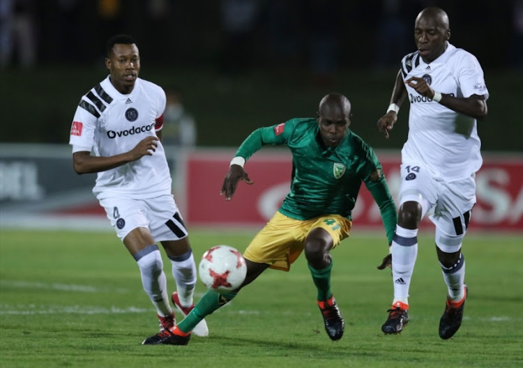 Lerato Lamola of Golden Arrows and Musa Nyatama of Orlando Pirates during the Absa Premiership match between Golden Arrows and Orlando Pirates at Princess Magogo Stadium on March 17, 2018 in Durban.