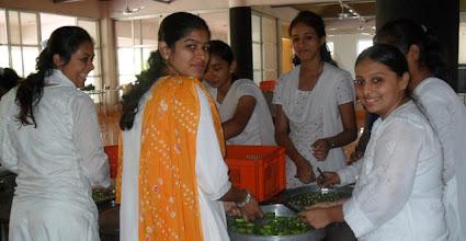 Photo: Girls giving seva to the ashram