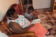 Sondezwa Poyana and her son Luphelo doing home schooling.
