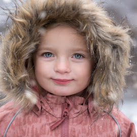 First snow by Nathalie Rouquette - Babies & Children Child Portraits ( girl, blue, snow, smile, eyes )