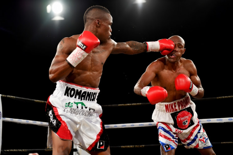 Lusanda Komanisi (L) lands a punch on his opponent Michael Mokoena (R) during the Call to Glory Boxing event from Emperors Palace on September 01, 2018 in Johannesburg, South Africa.