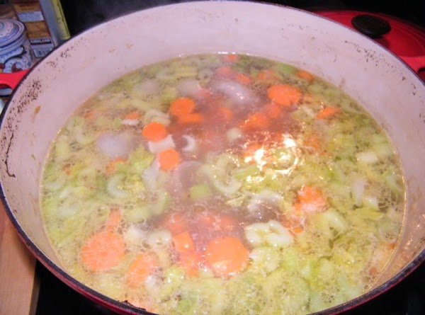 Add carrots and celery to the stock pot and continue to simmer.  Meanwhile...