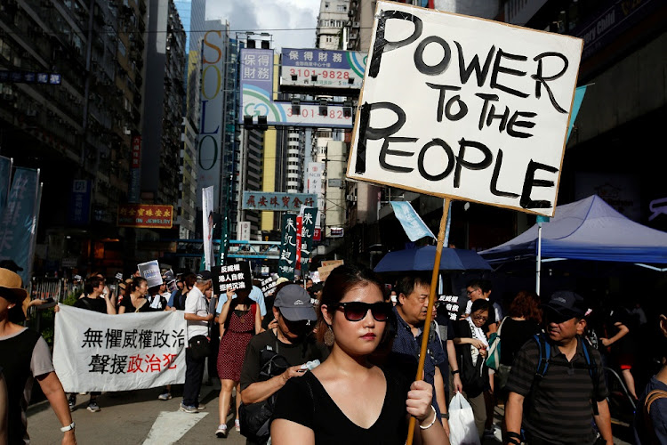 Pro-democracy activists take part in a protest on China's National Day in Hong Kong, China, on Sunday. Picture: REUTERS