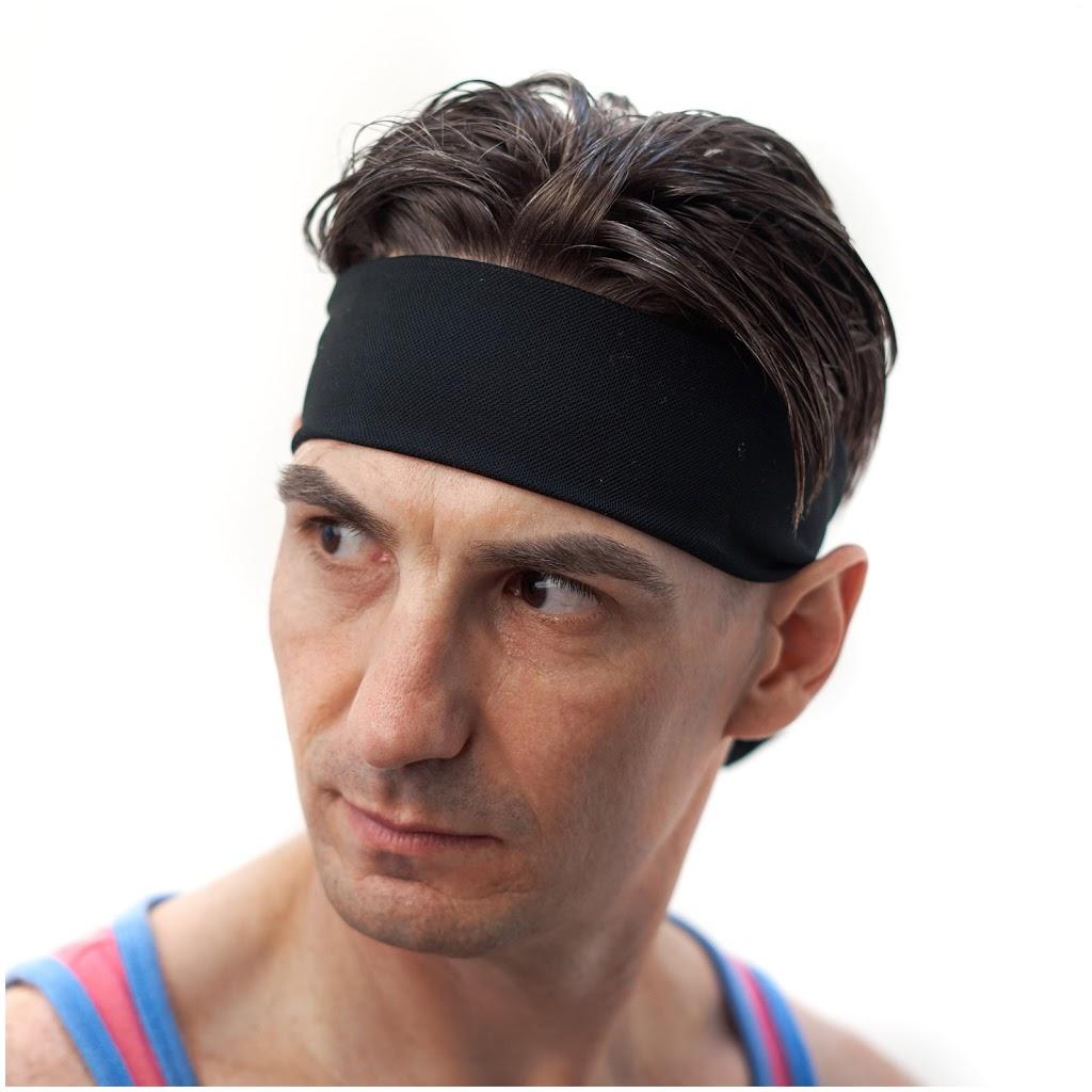 man wearing black tie behind headband