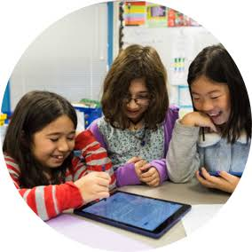 Three girls enjoy using technology to share their knowledge