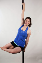 Photo: Vertical Pole Gymnastics - Carousel Spin with Z Legs