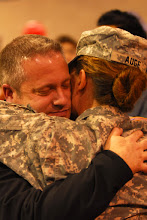 Photo: The third wave of 34th Infantry Division Soldiers returned to Inver Grove Heights, Minn. following their one-year deployment to Iraq.  The group of approximately 40 Soldiers arrived at 8 p.m. Feb. 5. Photo by Sgt. 1st Class Daniel Ewer.