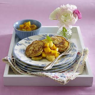 Rice Pudding Pancakes with Caramelized Banana and Mango.
