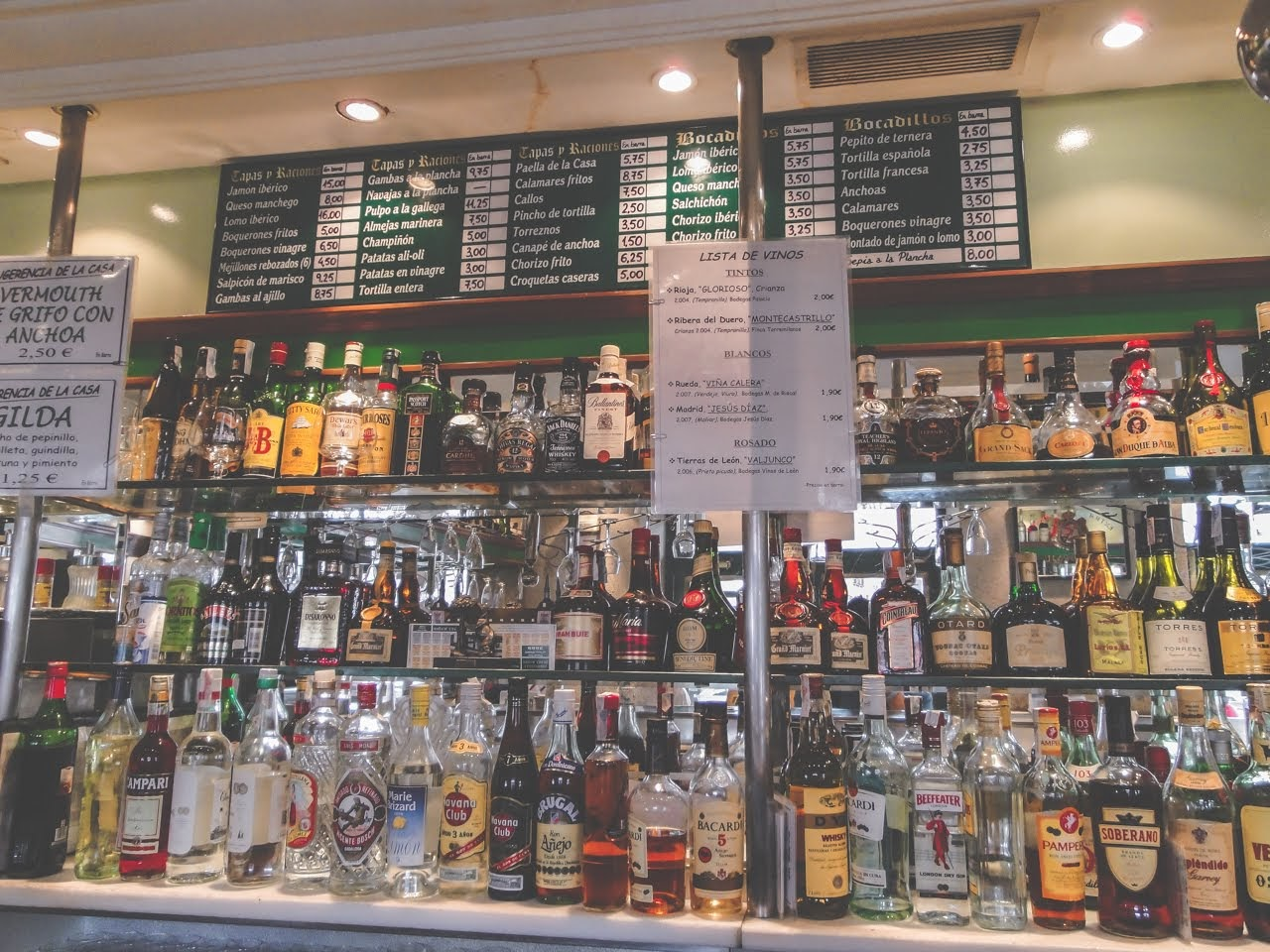 This bar has plenty of bottles of liquor and tapas to choose from