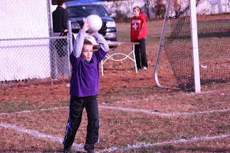 Photo: World Cup, Nov. 7--Peter throws it in.