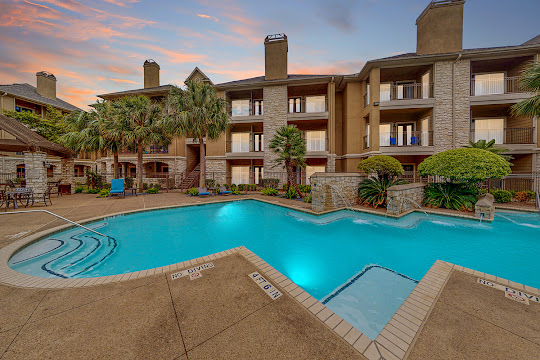 Retreat at Westchase apartment swimming pool surrounded by lounge chairs